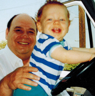 Baby Miles playing in the cab with his dad Big Bob watching